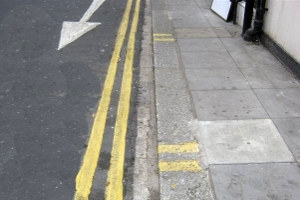 double yellow lines with yellow kerb markings