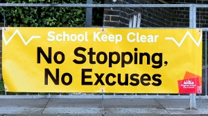 No Stopping No Excuses sign outside a local school