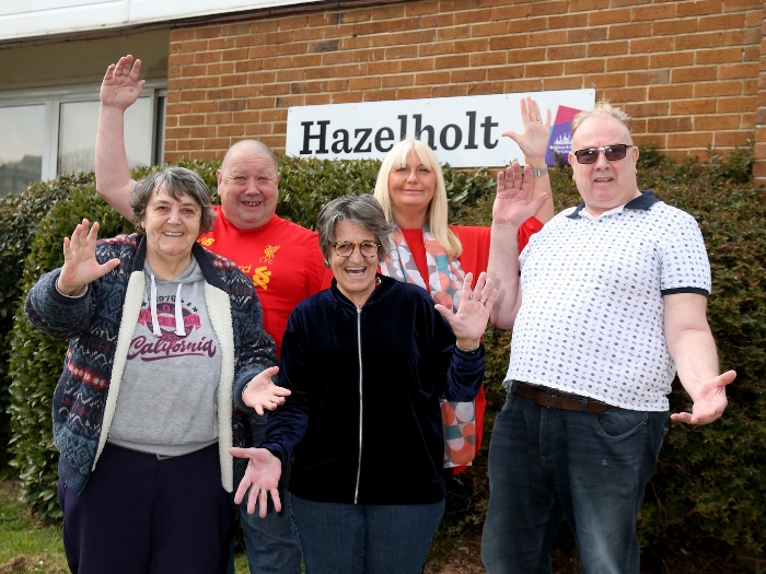 Residents stand in front of Hazelholt housing