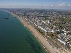 Aerial view of Brighton seafront with The Palace Pier an Hove seafront in the background