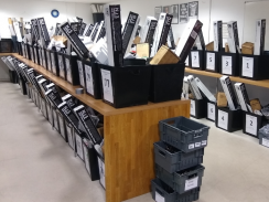 Rows of ballot boxes being filled with items for the election