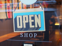 Picture of a shop sign reading 'Open'