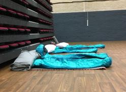 Sleeping bags in a hall