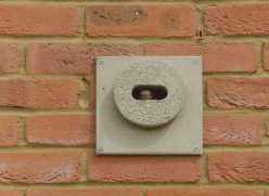 Swift brick erected in a brick wall, with swift inside