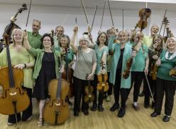 Photo of the Silver Strings music group holding their instruments