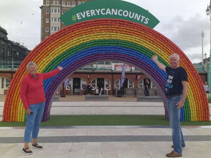 Councillor Sue Shanks, joint deputy leader of the council, and Rick Hindley, Director of Every Can Counts, in front of the recycled can rainbow arch.